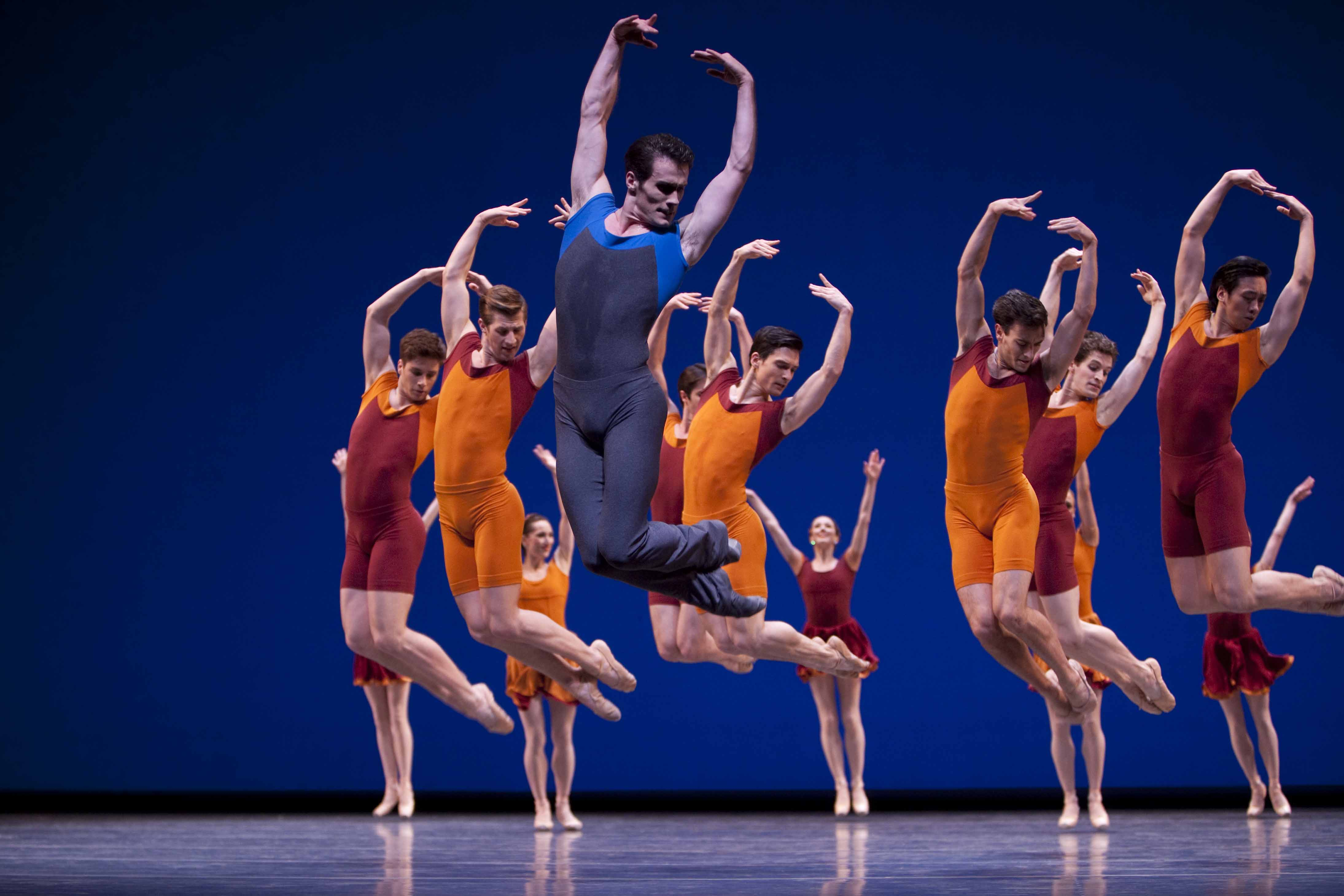 Pacific Northwest Ballet principal dancer Seth Orza with company dancers in Alexei Ratmansky's Concerto DSCH. Photo © Angela Sterling.